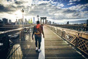 Brooklyn, here we come a man walking down a Brooklyn bridge