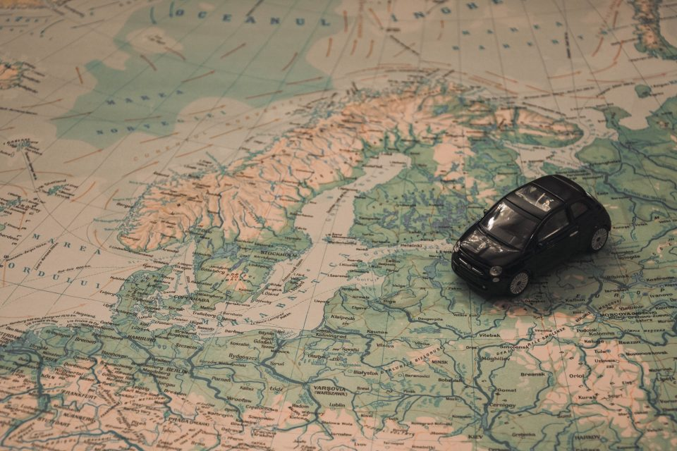 A car toy on a world map.
