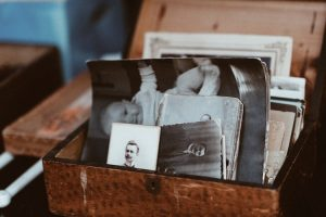 black and white photos in a wooden box