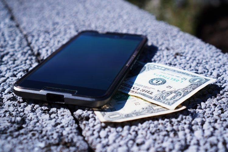a mobile phone and a banknote