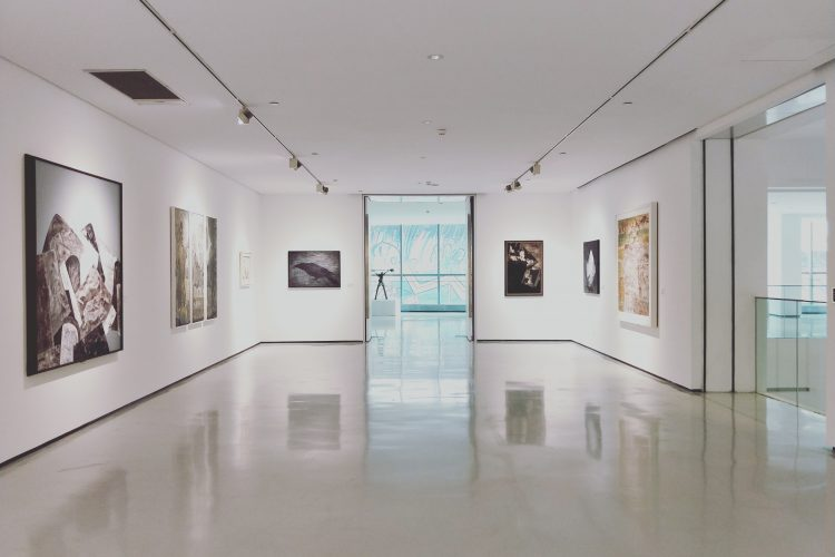 A modern galery, several paintings on the walls