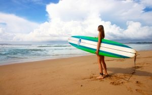 A girl preparing to surf.