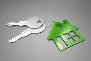 Keys on a house-themed keychain.