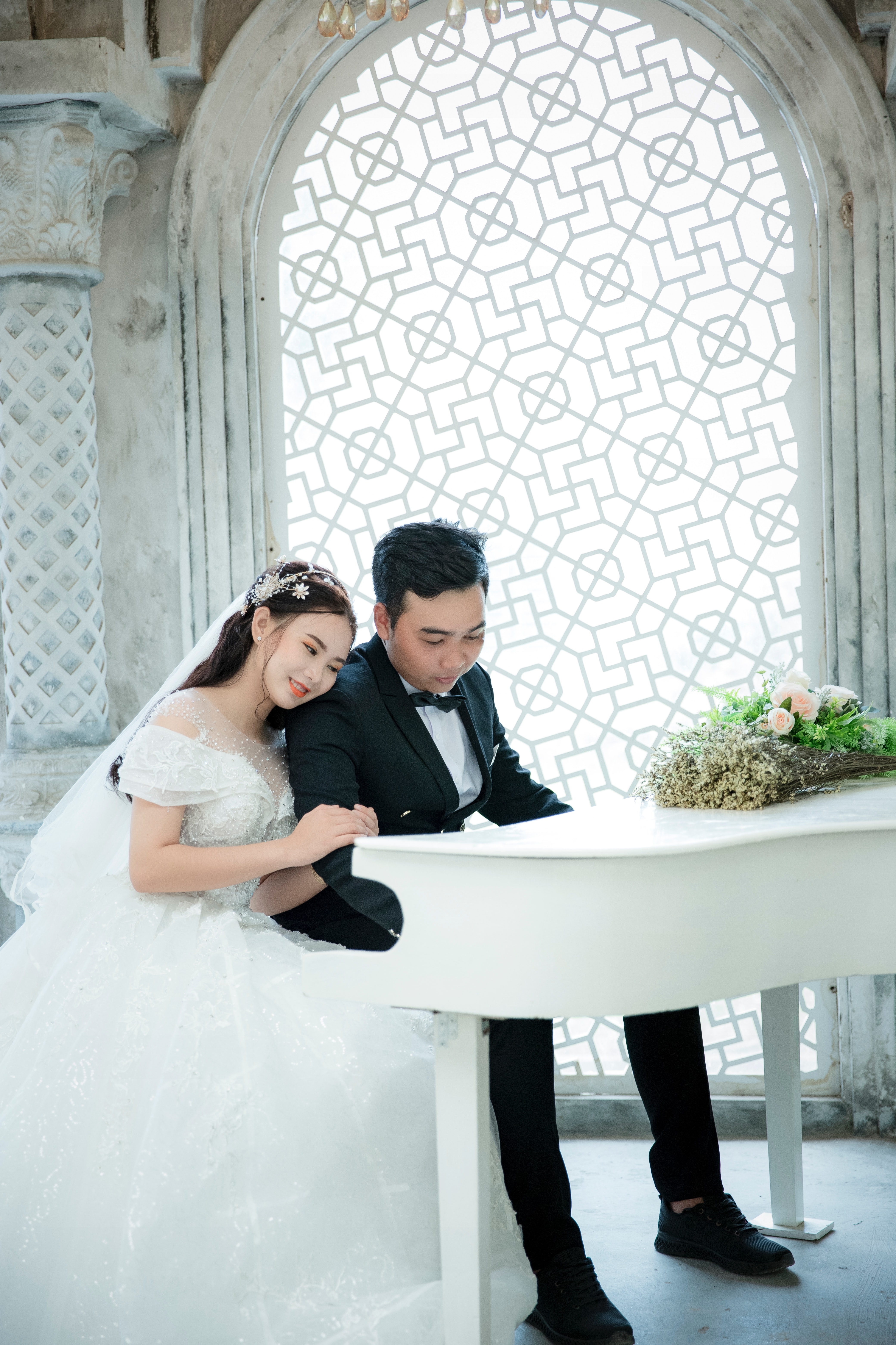 Bride and groom playing a piano
