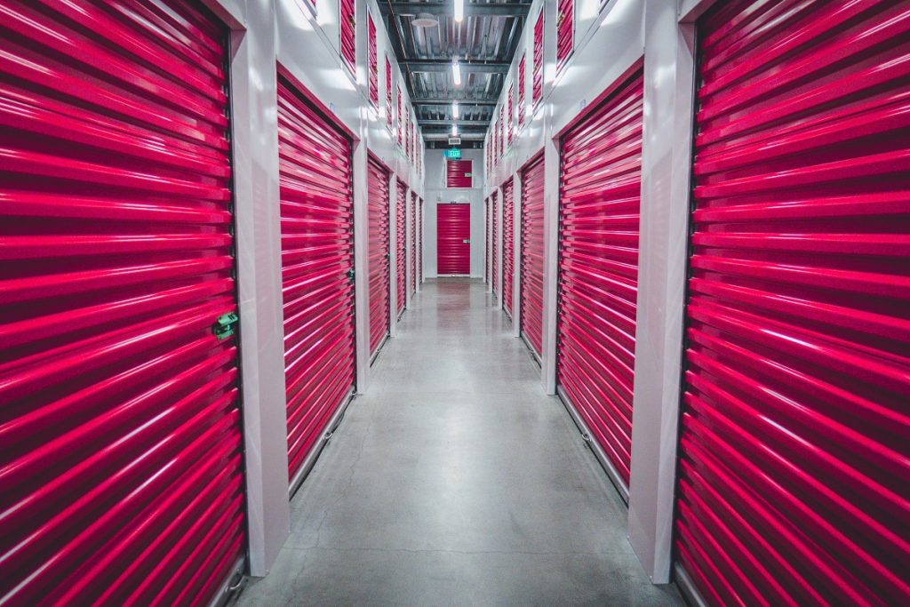 A hallway with doors leading to storage units Chicago.