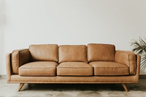 brown leather sofa with white background