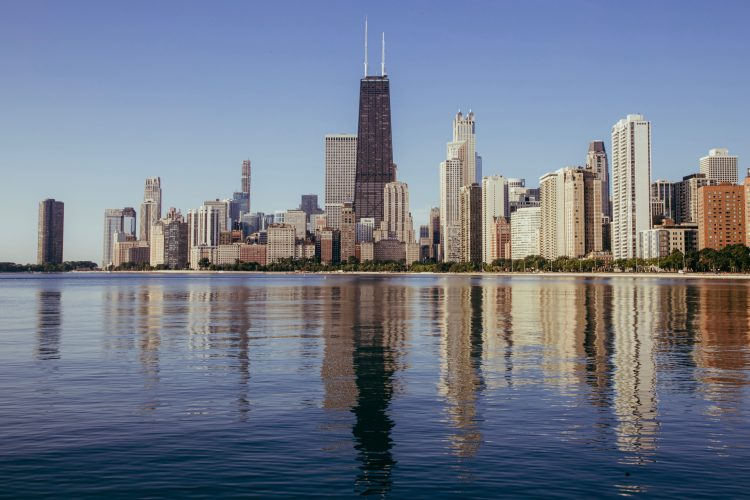 chicago skyline from river under blue sky