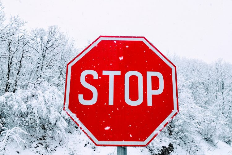 red stop sign in winter