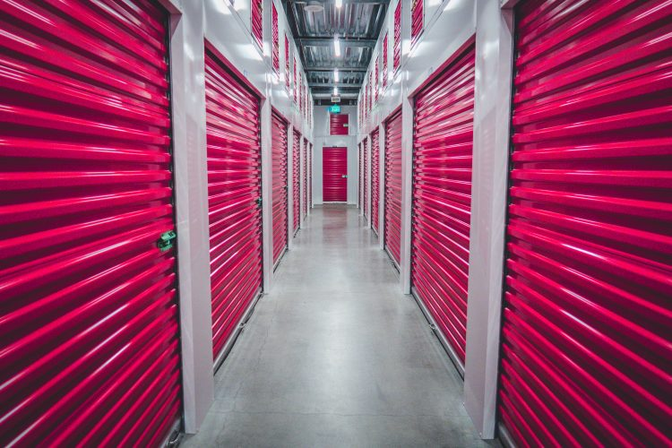 two rows of storage lockers with red doors