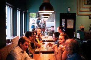 People talking in restaurant.