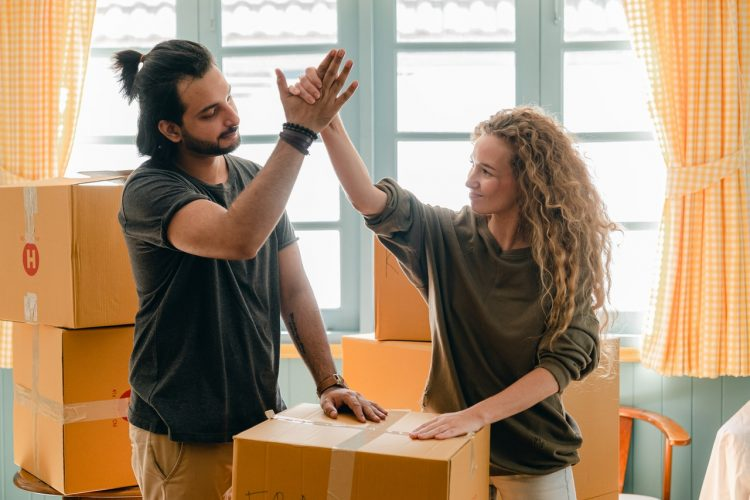 Couple congratulating each other on executing their week to week timeline
