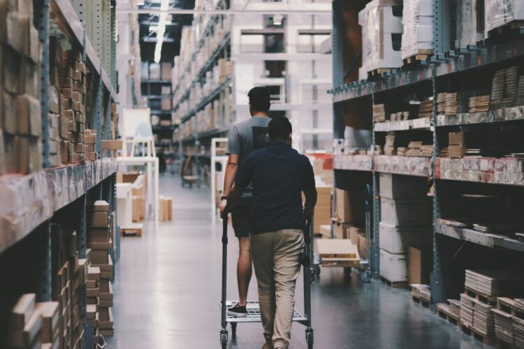 Workers help organizing business inventory in storage