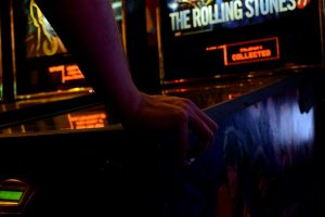 a person playing pinball