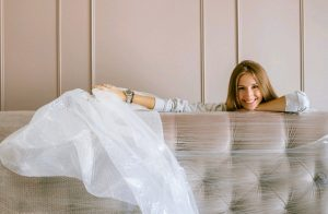a woman learning about Services furniture movers offer