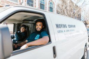 Movers driving in their van