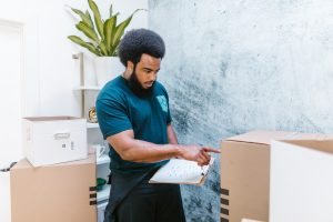 A mover looking at a box