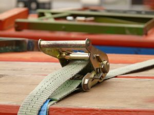 A turnbuckle and rope you can use to move a heavy sofa