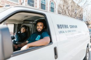 Movers inside a moving van