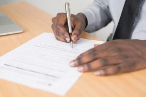 A person signing papers