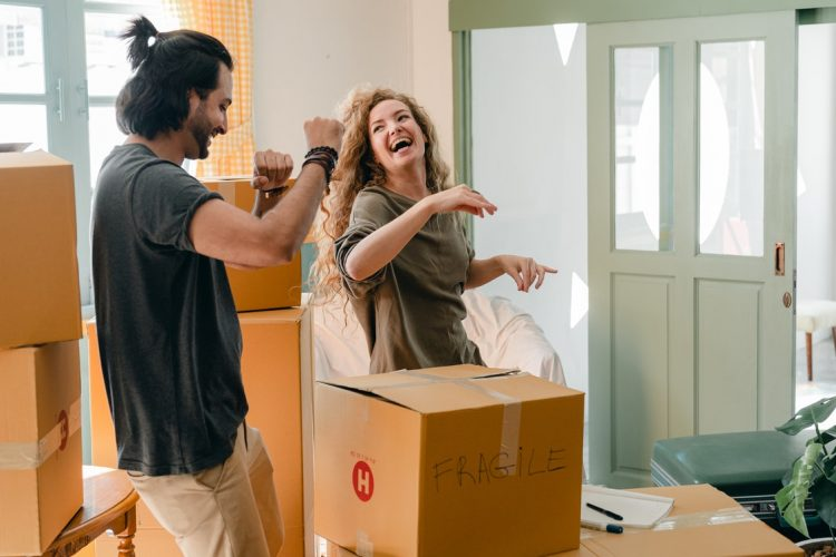 a couple laughing and packing