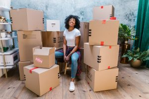 Woman packing for moving from Chicago to Atlanta